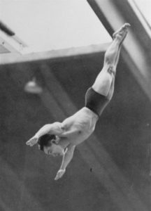 Dr. Sammy Lee, U.S. Army Medical Lieutenant from Pasadena, Calif., dives from the tower of the Empire Pool in Wembley, England, August 5, 1948 in the Olympic Tower Diving Championships. Lee, after winning championship today, announced he would retire form sport to devote his time to medicine. (AP Photo) NYTCREDIT: Associated Press