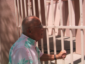Dr. Lee in 2004 looking into the same pool he was forbidden from swimming in back in 1932. Today, he is their honored guest and always welcome, thanks to his activism against racism.