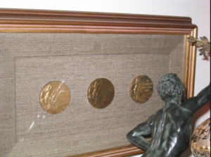 Dr. Sammy Lee's 1948 Gold and Bronze medals and 1952 Gold medal in diving