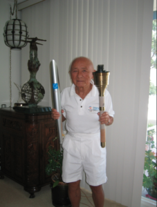 Dr. Sammy Lee holding his two Olympic torches (Summer '84/Los Angeles and Summer '96/Atlanta) (2004)